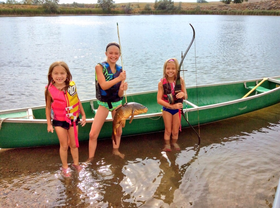 Some Proud Girls! They did an awesome job paddling the canoe into some carp!